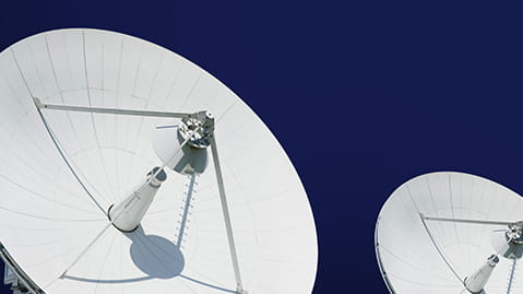 Large white satellite array against a blue sky