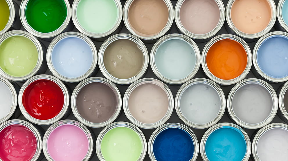 Three rows of open paint pots showing different colour paint