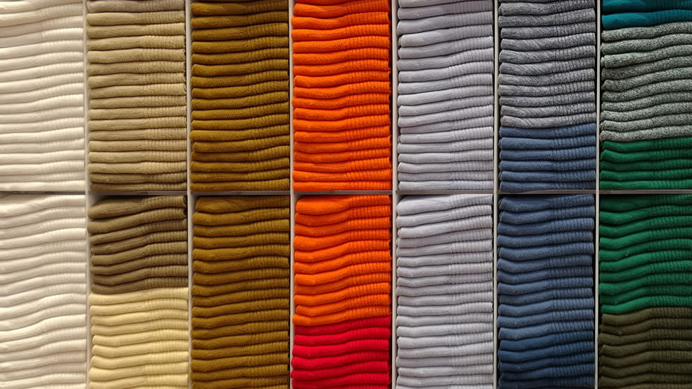 Columns of folded jumpers of varying colours