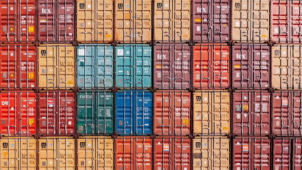 Shipping containers stacked into rows, end on