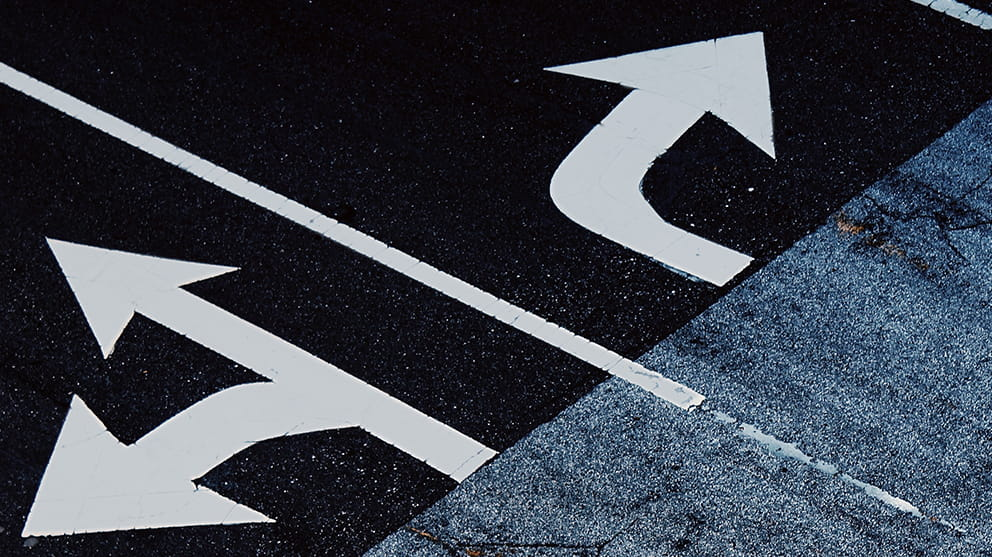 Close up of arrow road markings
