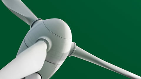 Close up of white wind turbine on a green background