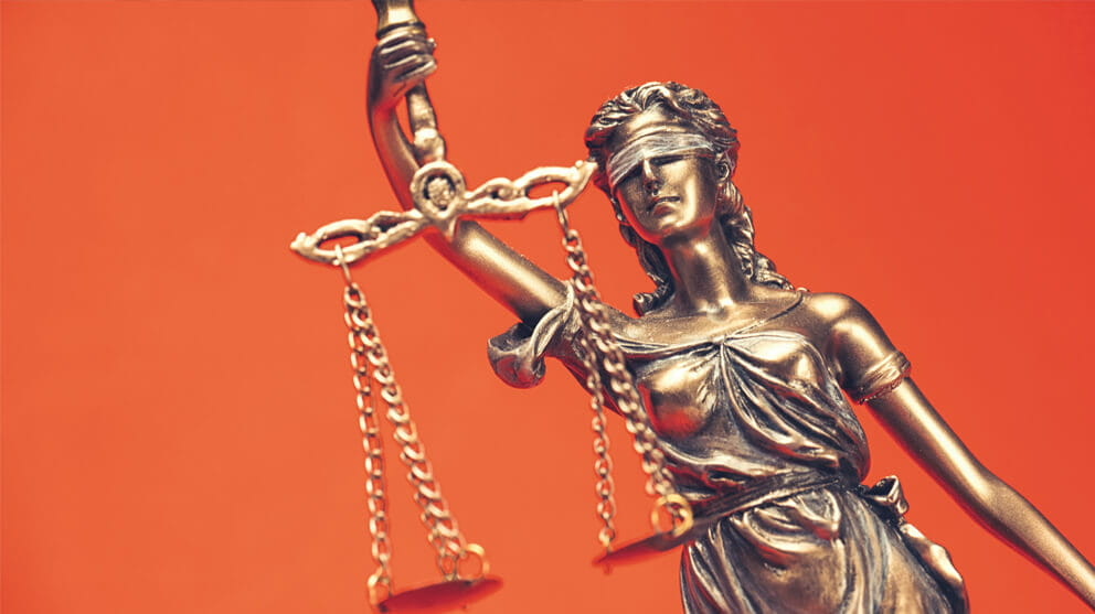 Close up of lady of justice on orange background