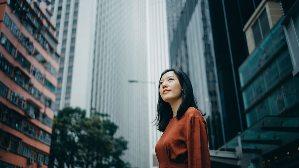 woman in front of skyscrapers
