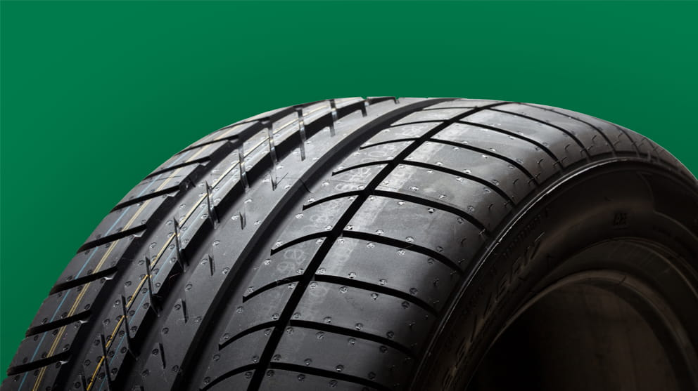 Tire on green background