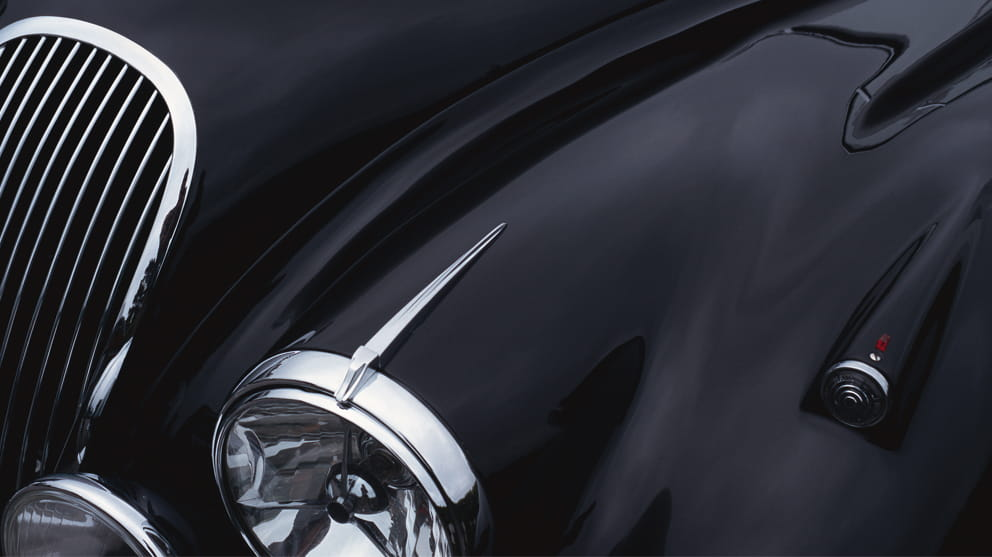 black sports car showing hood, grill and headlight