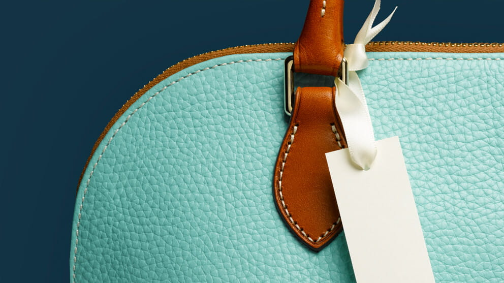 Blank Tag on Turquoise Handbag Close-Up