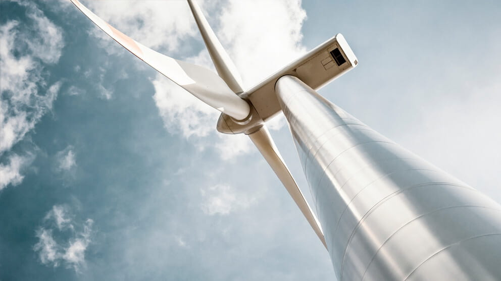wind turbine with blue gray sky