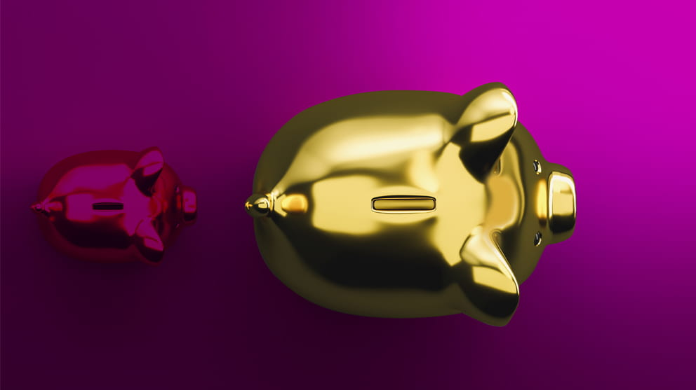 Piggy banks on pink background
