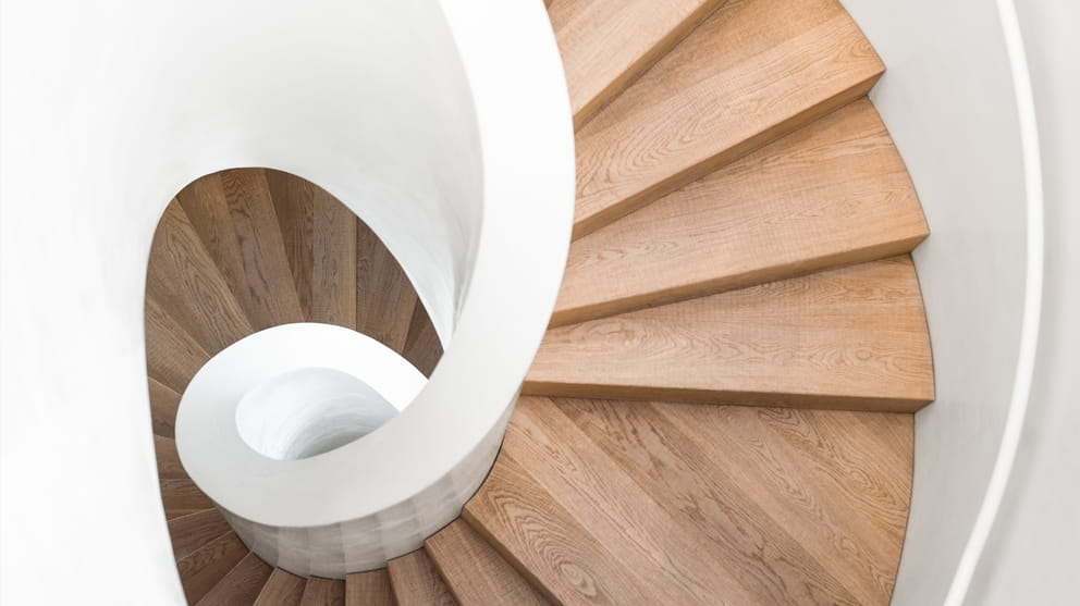 Top view spiral staircase white and wooden