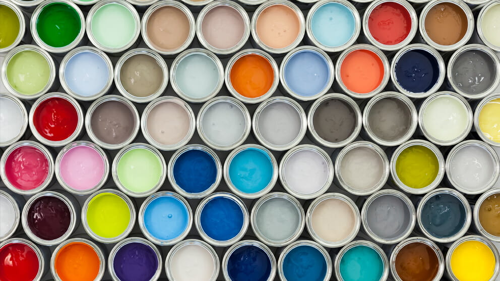 View from above of different coloured paint pots