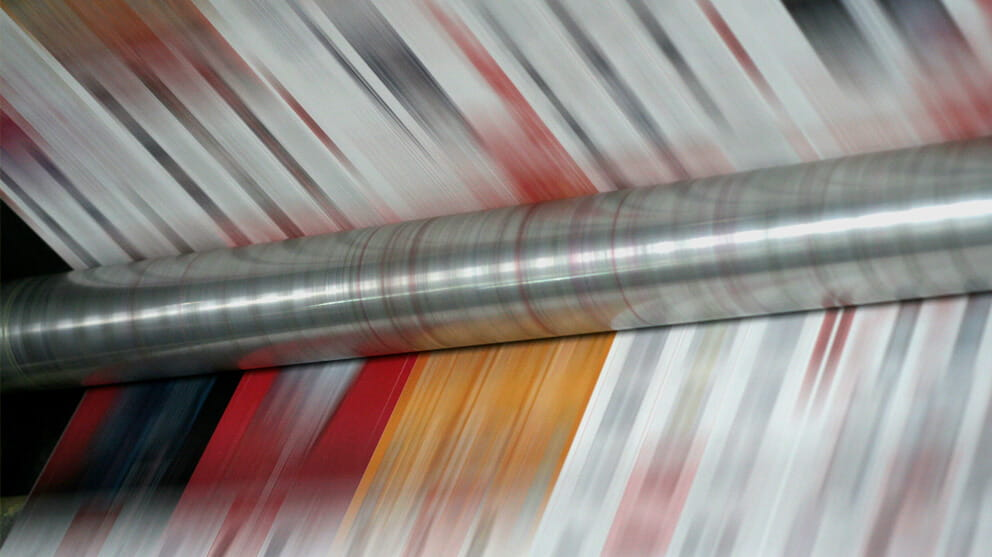 Paper rolling on a printer press