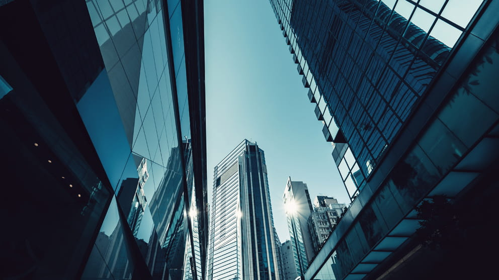 Tall glass city buildings - corporate M&A