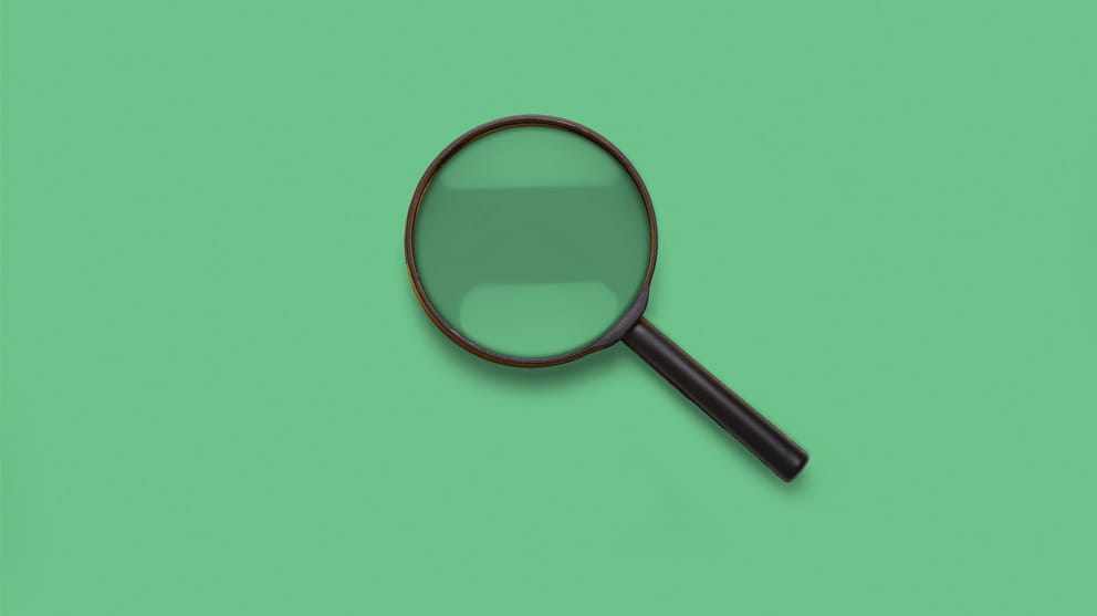 close up magnifying glass on green background