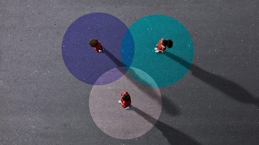 View from above of people standing on painted Venn Diagrams