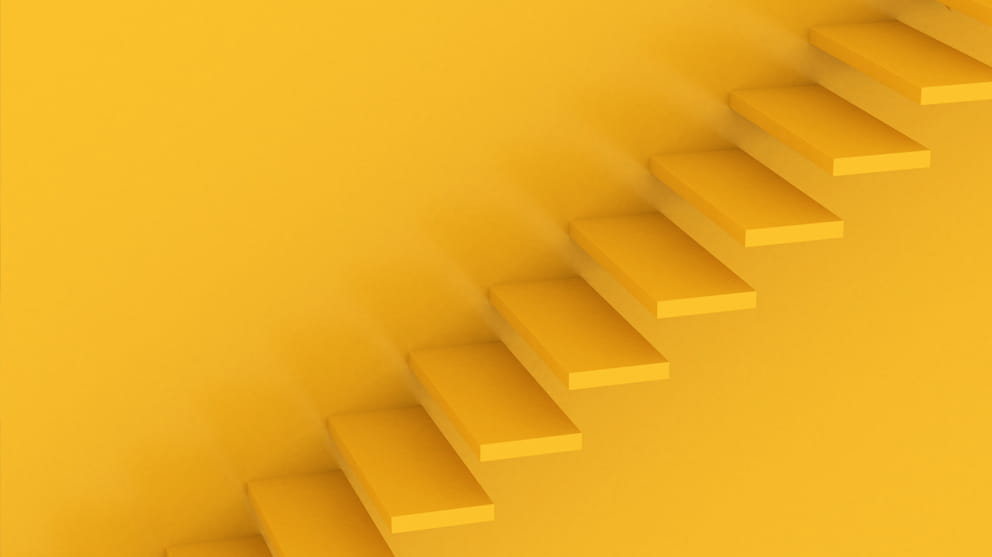 Stairs from left to right on an orange background