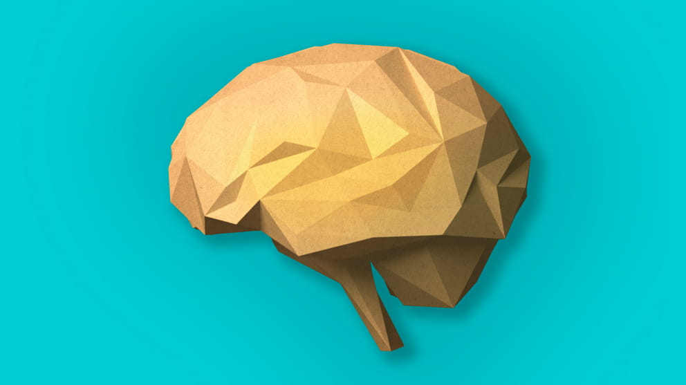 Paper craft brain on light blue background