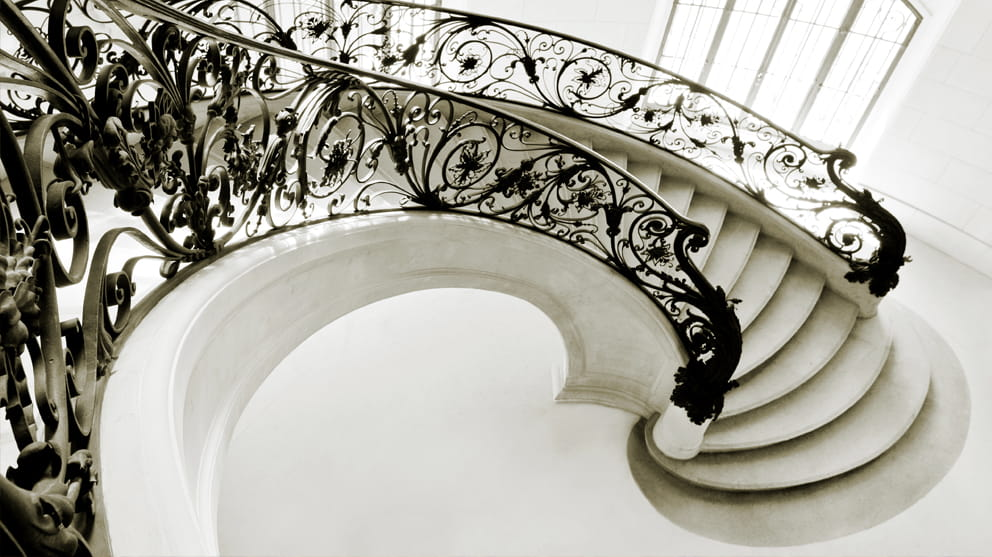 Spiral staircase with ornate railing