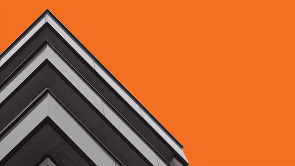 Close up of a corner of a building, with orange background